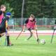 Beitragsbild Junior Camp 2020 abgesagt, 5 jugendliche Amputierten Fußballer beim Spiel auf einem Rasenplatz