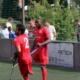 zwei Düsseldorfer Spieler jubeln nach einem Tor